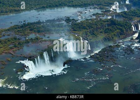 Walkway and Devil's Throat (Garganta do Diabo), Iguazu Falls, on Brazil - Argentina Border, South America - aerial - Stock Photo