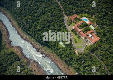 Belmond Hotel das Cataratas, and Iguazu River, Iguazu Falls, Parana State, Brazil, South America - aerial - Stock Photo