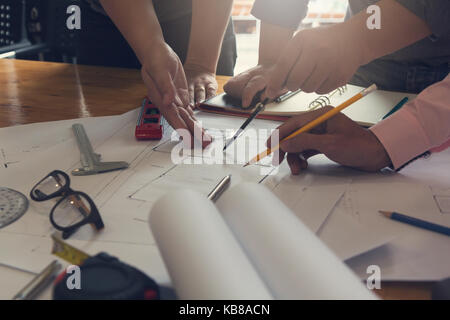 Engineer and Architect concept, Engineer Architects office team working and discussing house plan  model, Vintage - Stock Photo