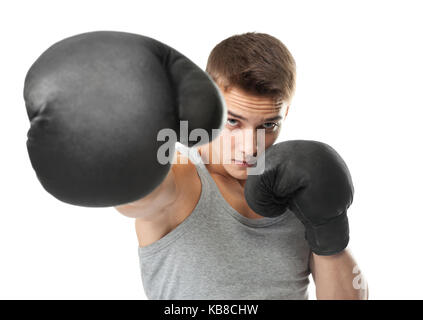 Portrait of young boxer throwing a punch at the camera isolated on white background - Stock Photo
