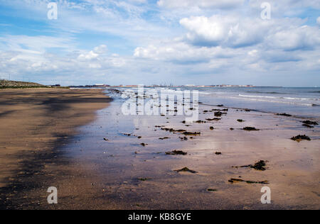 The Beach and Sea at Seaton Carew Hartlepool under Cloudy Skies - Stock Photo