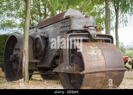 Old roller machine. Located in green summer park. - Stock Photo