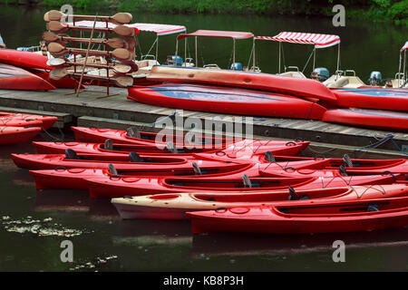 Kayaks rent point. The red boats on pier. - Stock Photo