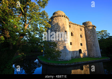 Castle ruins and moat in Nunney, Somerset, UK. - Stock Photo
