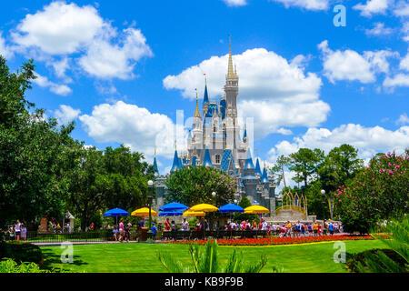 Landscape sunny bright photo of Cinderella's Castle at the Magic Kingdom, Disney World, Florida, USA against a blue - Stock Photo