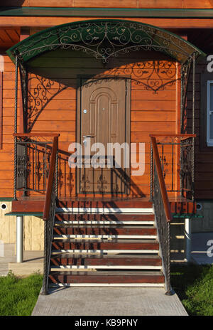 Front steps with wrought-iron fence closeup photo - Stock Photo