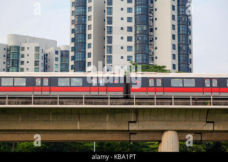 SINGAPORE - SEPTEMBER 11, 2017: Singapore's Mass Rapid Transit (SMRT) subway train travels on elevated rails through - Stock Photo