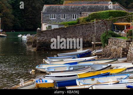 Beached dinghies tied up on the tidal shoreline of the River Yealm at Newton Ferrers, Devon, UK - Stock Photo