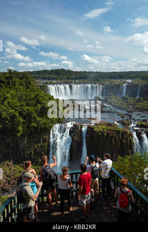 Tourists on viewing platform on Brazil side of Iguazu Falls, looking at Argentinian  side, South America