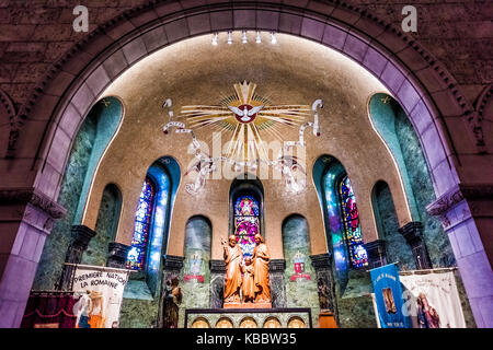 Sainte-Anne-de-Beaupre, Canada - June 2, 2017: Inside Basilica of Sainte Anne de Beaupre with statue and signs in - Stock Photo