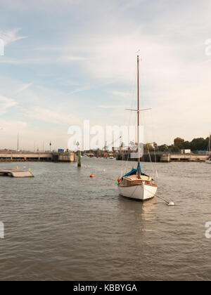 moored private white boat with mast in dock harbour; Essex; England; UK - Stock Photo