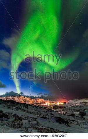 Northern lights above the fjord in Norway - Stock Photo