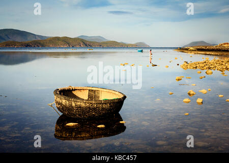 Basket boats at a lagoon on sunset in Song Lo, Phuoc Dong, Nha Trang, Vietnam. Nha Trang is well known for its beaches - Stock Photo