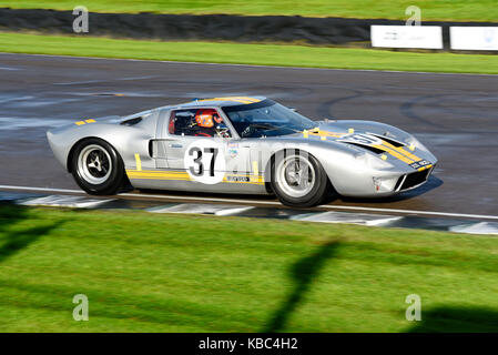 1965 Ford GT40 owned by Philip Walker driven by Mike Jordan racing in the Whitsun Trophy at Goodwood Revival 2017. - Stock Photo