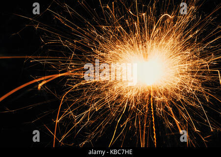 Side Angle View Of Sparkler During Night - Stock Photo