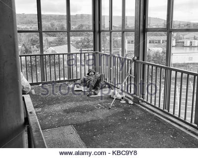 A homeless person sleeping rough in the bridge over the main railway line in neath town cetre south wales uk - Stock Photo