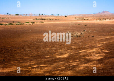 Empty flat desert fields in North  Sal Island, Cape Verde. Mirage at the horizon. Martian like landscape near Buracona - Stock Photo