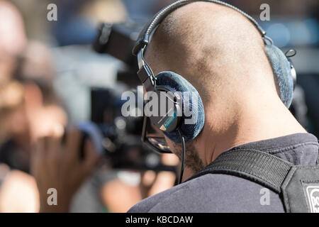 Milan, Italy - September 22, 2017: sound engineer with microphone and electronic equipment works during the Armani - Stock Photo
