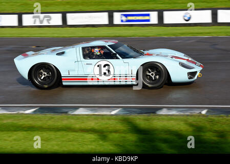 1965 Ford GT40 owned and driven by Shaun Lynn racing in the Whitsun Trophy at Goodwood Revival 2017. Space for copy - Stock Photo