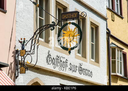 Typical wrought iron sign outside a hotel, Rothenburg ob der Tauber, Bavaria, Germany - Stock Photo