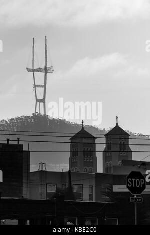 The Sutro Tower sits above and watches over San Francisco and transmits television and radio transmissions - Stock Photo