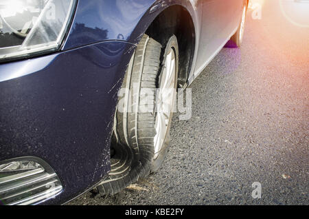 damaged tire after tire explosion at high speed on highway - Stock Photo