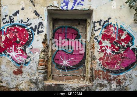 beautiful street art of graffiti abstract color creative drawing fashion on walls of city urban - Stock Photo