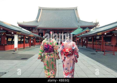Couple asian women wearing traditional japanese kimono in Sensoji temple in Tokyo, Japan. - Stock Photo