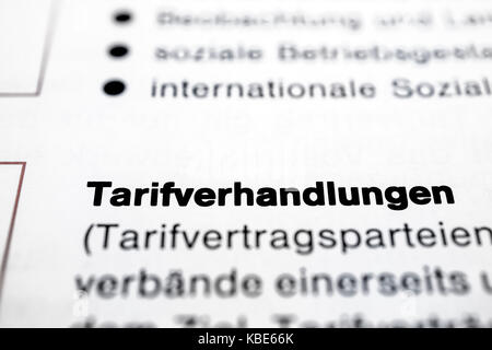 Text on page Collective Negotiations in  ( German - Tarifverhandlungen ) highlight horizontal closeup - Stock Photo