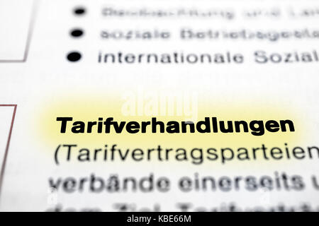 Text on page Collective Negotiations in  ( German - Tarifverhandlungen ) highlight horizontal closeup