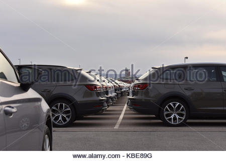 Rows of new cars ready for sale at dealer parking lot in Barcelona Spain Europe - Stock Photo