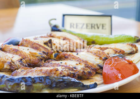 chicken wings plate, rezerved table - Stock Photo