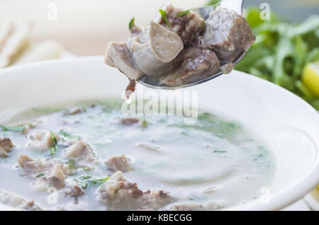 turkish traditional tripe soup; iskembe corbasi and offal soup - Stock Photo