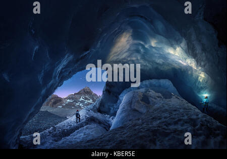 Cave Explorers in Athacasca Glacier Ice Cave in Canada. - Stock Photo