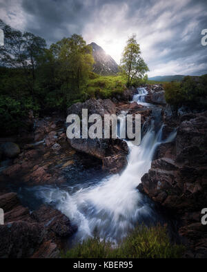 Buachaille Etive Mòr mountain and river, waterfall in Scorland, United Kingdom. - Stock Photo