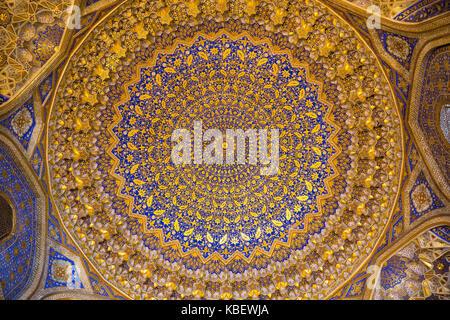 SAMARKAND, UZBEKISTAN - OCTOBER 15, 2016:  Interior of the mosque Tilya Kari Madrasah on Registan Square - Stock Photo
