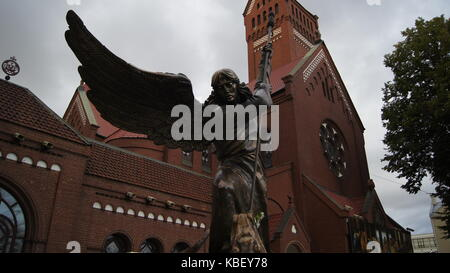 Statue of Archangel Michael, in front of the Saints Simon and Helena church (also known as the Red Church) , in - Stock Photo
