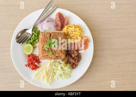 Mixed cooked rice with shrimp paste sauce, traditional Thai style food - Stock Photo