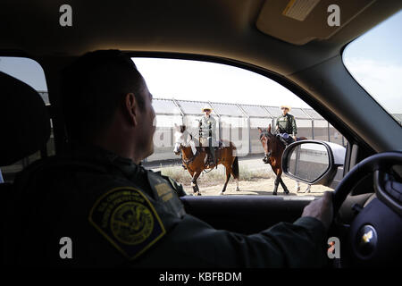 San Diego, California, USA. 29th Sep, 2017. US Border Patrol agent SAUL ROCHA, left, stops to say hello to fellow - Stock Photo