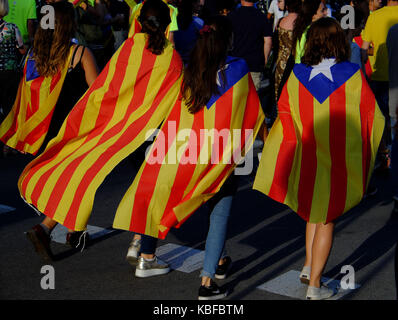 Barcelona, Spain. 11th Sep, 2017. The people of Barcelona wearing and carrying the Catalan flag, fill the streets - Stock Photo