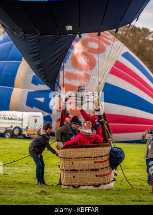 York, UK. 30th September, 2017. A mass balloon launch took place at sunrise from York Knavesmire as part of the first ever York Balloon Fiesta. Over 30 balloons took to the skies watched by hundreds of onlookers. The launch is part of a three day event which runs until Sunday the 1st of October. Photo Bailey-Cooper Photography/Alamy Live News
