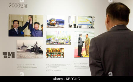Observatory in DMZ, Sep 29, 2017 : A South Korean man looks at pictures of the historic inter-Korean summits displayed - Stock Photo