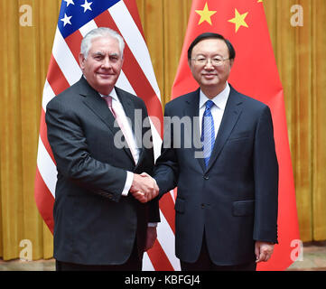 Beijing, China. 30th Sep, 2017. Chinese State Councilor Yang Jiechi (R) meets with visiting U.S. Secretary of State - Stock Photo