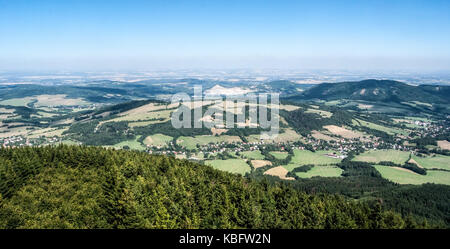 view to north from Velky Javornik hill in Moravskoslezske Beskydy mountains with countryside, villages, small hills - Stock Photo