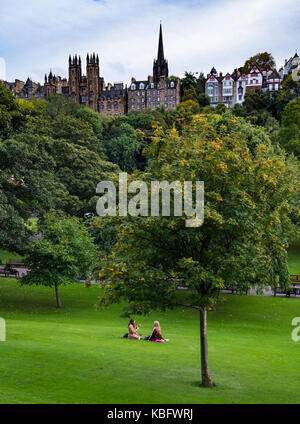 View across Princes Street Gardens to The Mound and the Old Town in Edinburgh, Scotland, United Kingdom. - Stock Photo