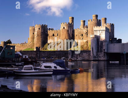 Looking across the calm waters of the River Conwy towards Conwy Castle, Clwyd, North Wales - Stock Photo
