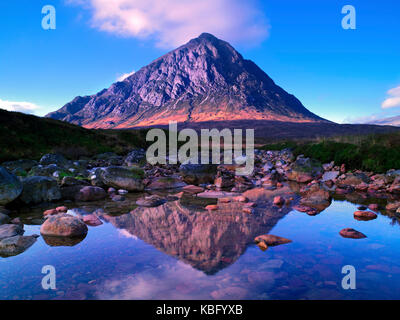 A sunny view of the famous mountain Buachaille Etive Mor and its reflection, on Rannoch Moor in the Scottish Highlands - Stock Photo