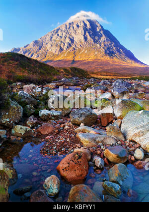 A sunny view of the famous mountain Buachaille Etive Mor in Rannoch Moor in the Scottish Highlands - Stock Photo