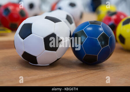 Close-up of footballs on wooden table