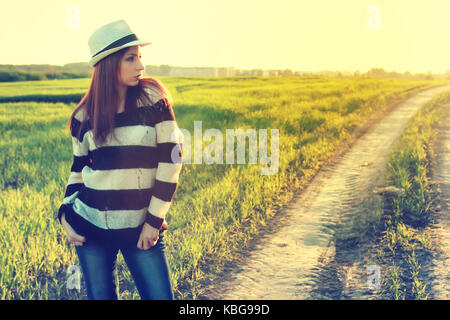 girl in hat fashion field sunset  - Stock Photo